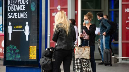 Passengers flying from Malaga arrive at Birmingham Airport, following an announcement on Saturday th