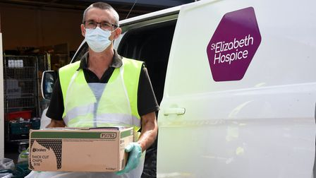 Steve Bond sorting out the hardware items donated to St Elizabeth Hospice Picture: CHARLOTTE BOND