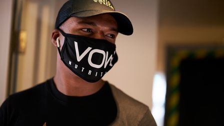 Ipswich boxer Fabio Wardley sports a facemask as he arrives at Matchroom Fight Camp. He fights Simon