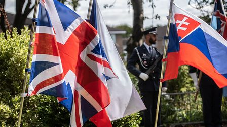 Flags fly at the ceremony to commemorate the formation of 311 (Czechoslovak) Squadron at RAF Honingt