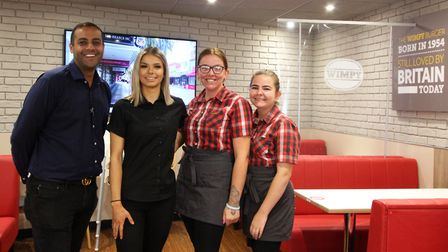 Raj Bhangal, left, with his team at the new-look Wimpy in Colchester Picture: CRAIG DEWAR