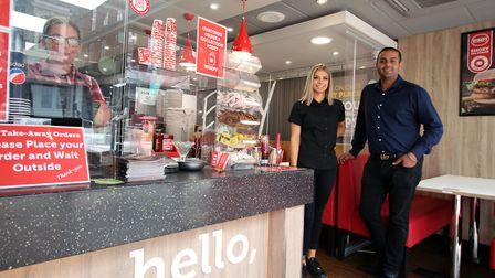 Raj Bhangal (right) with manager Wiki Fratczak at the newly-refurbished Wimpy Colchester Picture: C