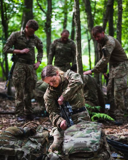 Flying Officer Juliette Abson prepares her kit on exercise while traaining to become one of the firs