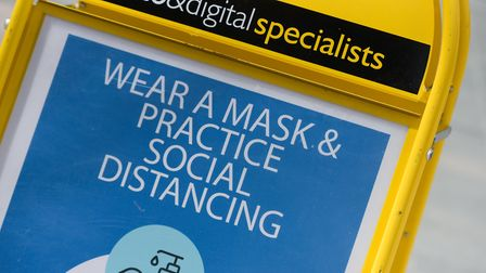 A sign reminding people to socially distance and wear a mask Picture: SARAH LUCY BROWN