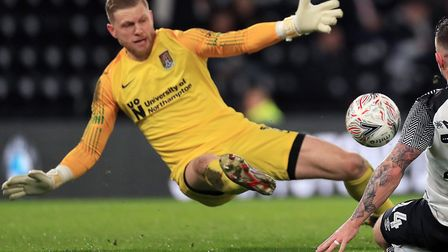 David Cornell makes a save for Northampton. Picture: PA
