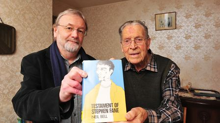 Far East Prisoner of War Cyril Doy with a copy of a book that he read whilst a in a prison camp near