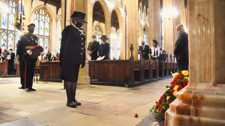 The Lord Lieutenant of Suffolk, Clare, the Countess of Euston, bows her head after laying a wreath a