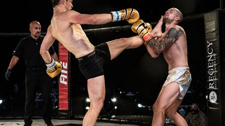 Dean Pattinson lands a teep to the chin of Charlie O'Neill in their main event at Contenders 30 Pict