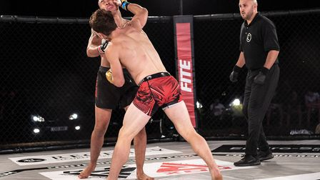 Richard Mearns lands a right hand on Stefano Catacoli in their thriller at Contenders 30 Picture: BR