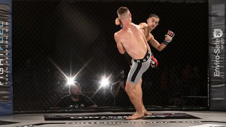 Phil Taylor lands the perfect counter head kick on Luke Goodge at Contenders 30 Picture: BRETT KING