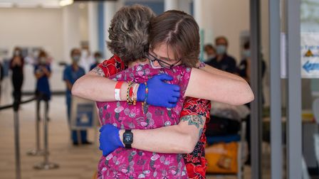 Heart transplant patient Richard Priest hugs his wife Rachael for the first time in eight months, as