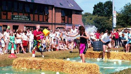 Keeping cool at the Bury St Edmunds carnival, It's A Knockout competition at the town's Rugby Club i
