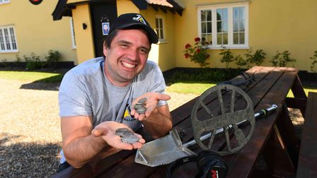 Luke Mahoney and his friends discovered silver coins near a Suffolk pub in July Picture: MINELAB MET