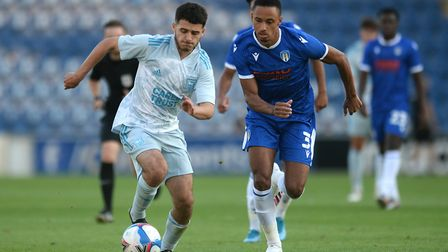 Ipswich Town's Armanda Dobra looks to get past Cohen Bramall of Colchester United Picture: RICHARD B