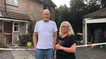 Mark and Lyn Young outside their Woolpit home the morning after the fire. Picture: MARK LANGFORD