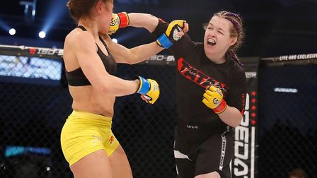 Cory McKenna, right, beat Vanessa Demopoulos in Las Vegas. Picture: DOLLY CLEW/CAGE WARRIORS