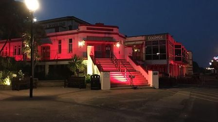 The Spa Pavilion lit up in red to aupport the campaign to help the events industry Picture: BREEZE E