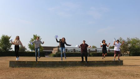 Students jumping for joy after receiving their A-Level results, despite not taking any examinations