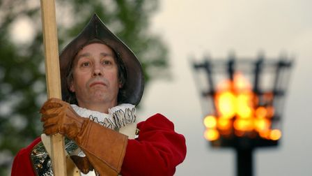 Rob Brown, Clerk to the Colchester Watch in 2003, standing guard to the May Day beacon in Colchester