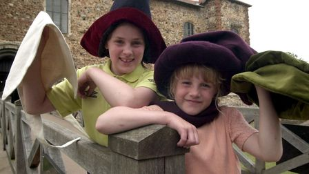 Youngsters showing off new hats to be displayed at Colchester Castle in 2002 Picture: CLIFFORD HICKS