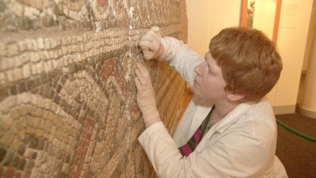 Work taking place on a Roman mosaic at Colchester Castle Museum in 2002 Picture: NICK STRUGNELL
