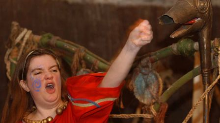 'Boudica' giving a talk at Colchester Castle in 2004 and showing the children how to give a war cry