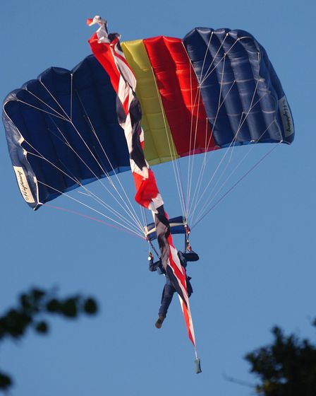 An army parachutist comes in for a perfect landing before the Beating the Retreat ceremony at Colch