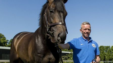 Michael Curran with 2015 Derby winner Golden Horn at Clarehaven Stables, Newmarket Picture: PAUL HA