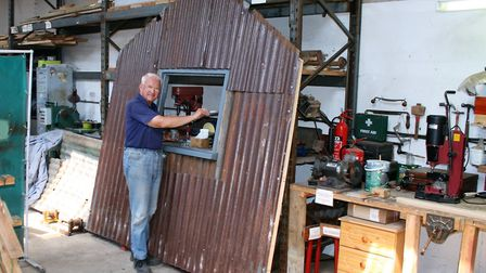 Brian Scott is helping to restore what will become the shelter at Aspall Halt. Picture: PAUL GEATER