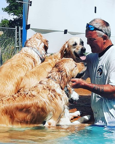 Andy with a pack of happy customers Picture: Canine Dip and Dive
