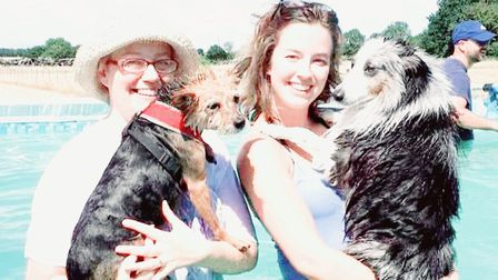 A pair of happy customers with their fur babies Picture: Canine Dip and Dive