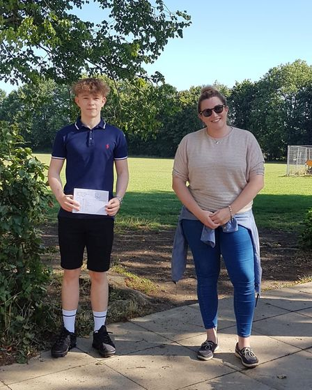 Fred Allsop acheived top GCSE grades at Stowupland High School. He is stood next to his maths teache