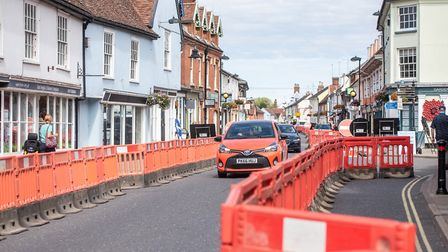 The barriers create a single lane for cars and give pedestrians more space to walk but the one-way s