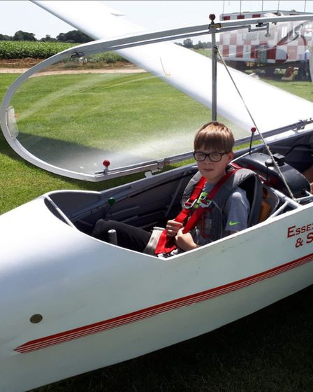 Isaac Jones, who was 13 at the time this photo was taken, sitting inside a glider for the very first