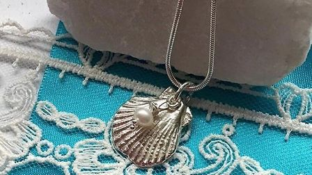 A small scallop shell crafted from silver clay, adorned with a freshwater pearl Picture: Sue Studd