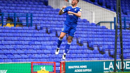 Luke Chambers jumps for joy after scoring in front of an empty South Stand. Photo: Steve Waller