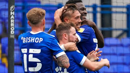 Luke Chambers is congratulated by Teddy Bishop, Alan Judge and Toto Nsiala after his header put Ipsw
