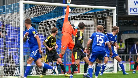 Luke Chambers (far left) glances home a corner to put Ipswich Town two goals ahead just before the b