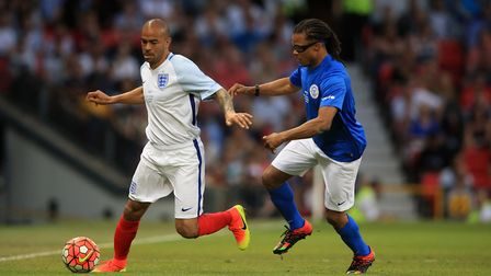 England's Kieron Dyer (left) and Rest of the World's Edgar Davids battle for the ball during Soccer