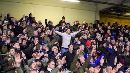 Town fans celebrate after the 1-0 victory over Lincoln. They have been patient for long enough. Now