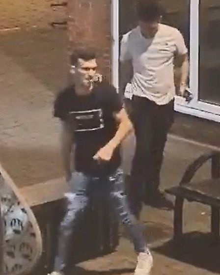 Once the bin is pushed over the two men start to walk away. Picture: CHARLOTTE WARMAN