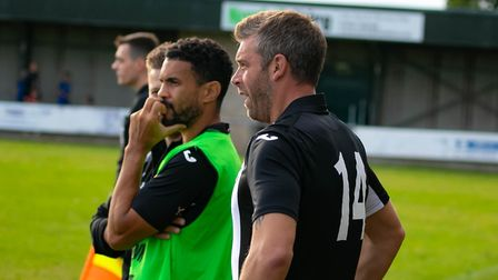 Woodbridge Town managers Jamie Scales, gets ready to come on as a substitute while Carlos Edwards ta