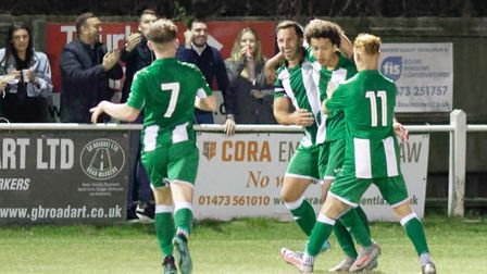 Mydas Smalls is congratulated by his Whitton United team-mates after scoring against Ipswich Wandere