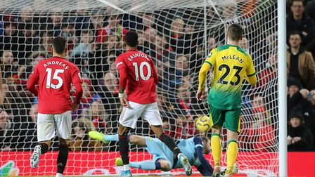 Manchester United's Marcus Rashford scoring a penalty against Norwich City in the Premier League. Un