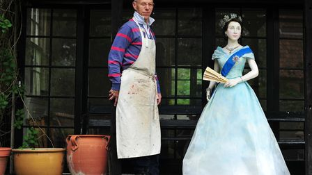 Yoxford artist Michael Stennett with his life size effigy of the Queen on her coronation, with her e