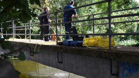 Police divers on the bridge as the search the River Stour at Sudbury continues Picture: DENISE BRADL