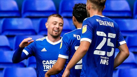 Freddie Sears is congratulated by Andre Dozzell and Aaron Drinan after scoring his second and Town's