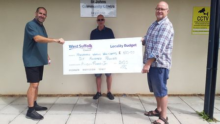 Councillors Richard Alecock, left, Andy Neal and Ian Shipp with the locality budget cheque for the W