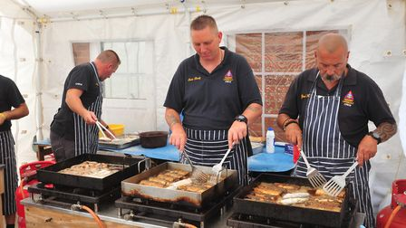 Hemsby lifeboat crew cooking at a past Hemsby Herring festival Picture: ARCHANT