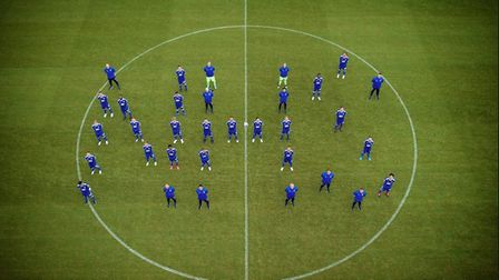 Ipswich Town players spell out the letters NHS at their squad photo shoot. Photo: ITFC